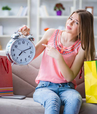 Young woman with shopping bags indoors home on sofa Stock fotó - 129287723