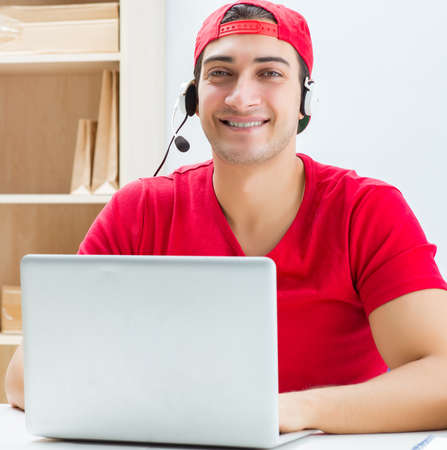 Call center worker at parcel distribution center in post office