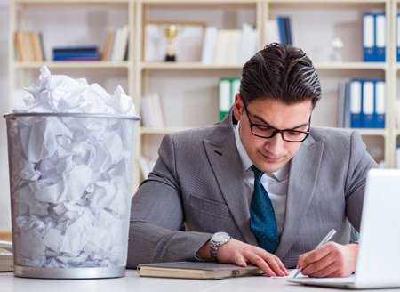 Businessman in paper recycling concept in office 写真素材