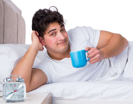 Man in bed suffering from insomnia Stockfoto