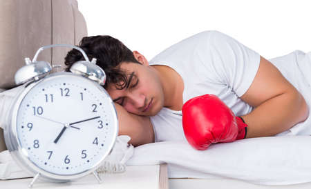 Man in bed suffering from insomnia Stock fotó