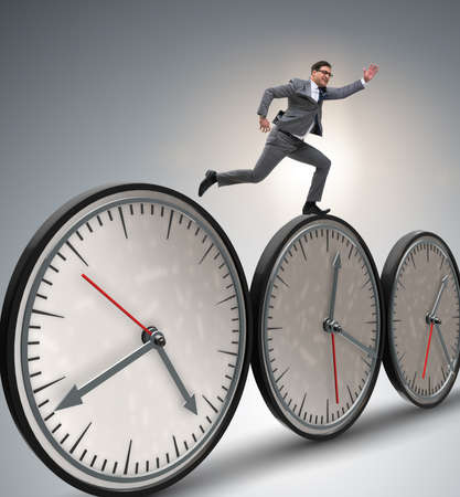 Businessman in time management concept Stock fotó