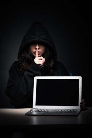 Female hacker hacking security firewall late in office Stok Fotoğraf