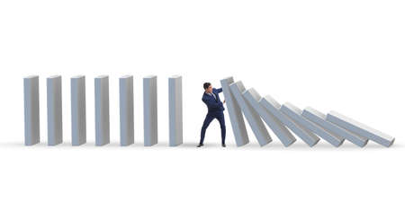 Businessman preventing domino effect in business concept Stockfoto