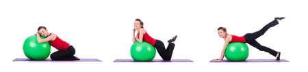 Young woman exercising with swiss ball 写真素材