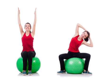 Young woman exercising with swiss ball Stockfoto