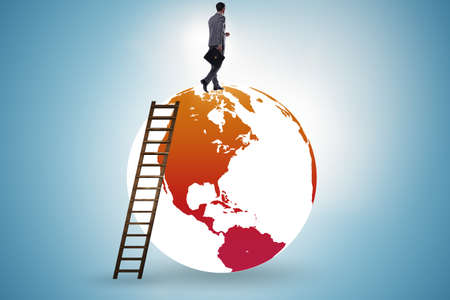 Businessman on top of the world Stock Photo - 129793274