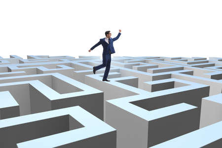Businessman trying to escape from maze Stockfoto