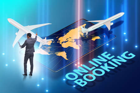 Concept of online air travel booking with businessman Reklamní fotografie