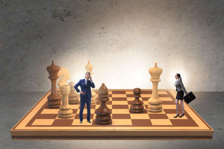 Businessman in large chess board in strategy concept