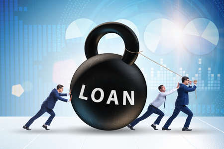 Debt and loan concept with businessman pulling kettlebell Stok Fotoğraf - 129780778