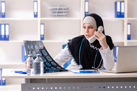 Young doctor in hijab working in the clinic Stok Fotoğraf