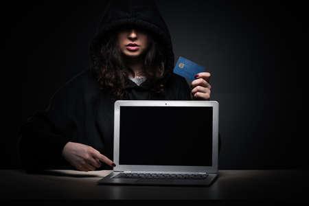 Female hacker hacking security firewall late in office Zdjęcie Seryjne