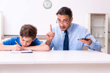 Busy father helping his son to prepare for exam Zdjęcie Seryjne - 129780921
