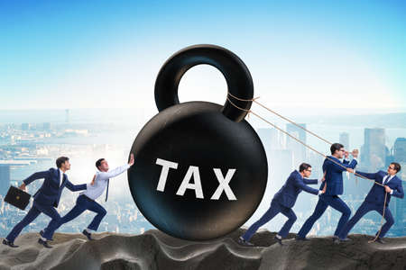 Businessman pulling kettlebell in tax concept
