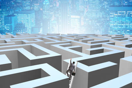 Businessman trying to escape from maze 版權商用圖片