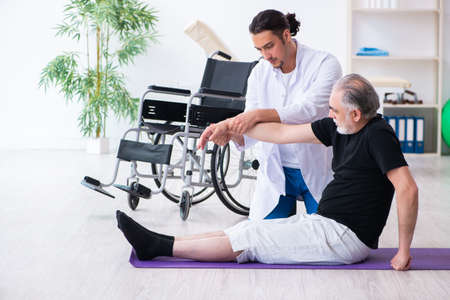 Aged patient recovering from injury in hospital Stock Photo