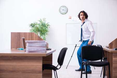 Young male employee unhappy with excessive work Stock fotó