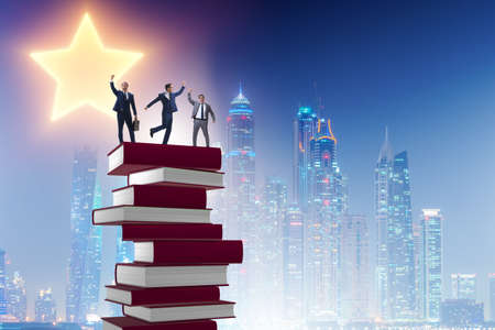 Business education concept with businessman and books Фото со стока