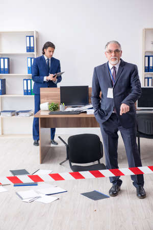 Two experts criminologists working in the office Zdjęcie Seryjne - 129795554