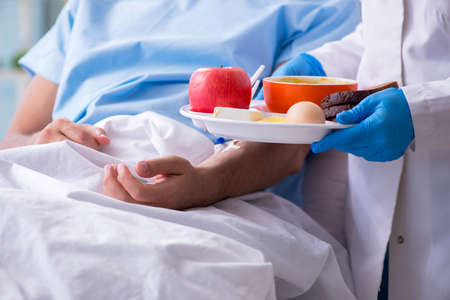 Male patient eating food in the hospital