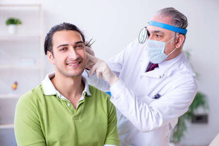 Male patient visiting doctor otolaryngologist
