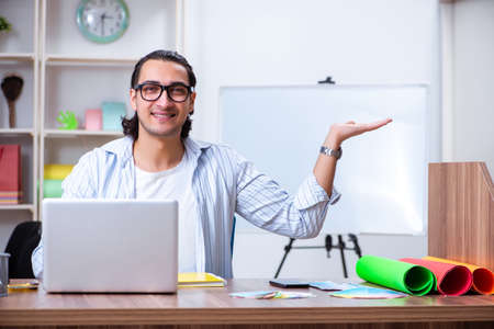 Young male designer working in the office Stock Photo