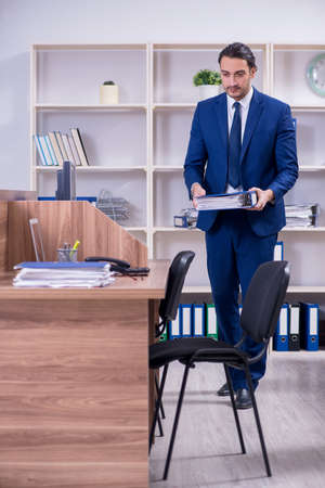 Young handsome businessman working in the office Stock fotó - 129922853