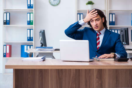 Young male businessman working in the office