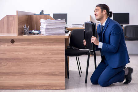Young handsome businessman working in the office Stock fotó - 129923225