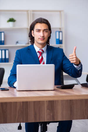 Young male businessman working in the office Stock fotó - 129923305