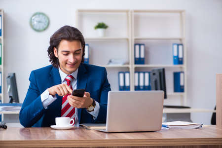 Young male businessman working in the office Stock fotó - 129923307