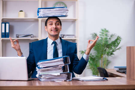 Young handsome businessman working in the office Stock fotó - 129923430