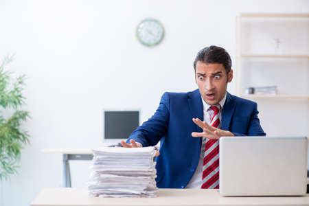 Young male businessman sitting in the office Stock fotó