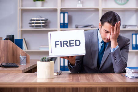 Young male employee being fired from his work