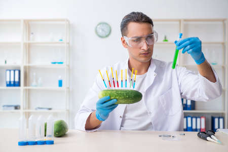 Male nutrition expert testing vegetables in lab