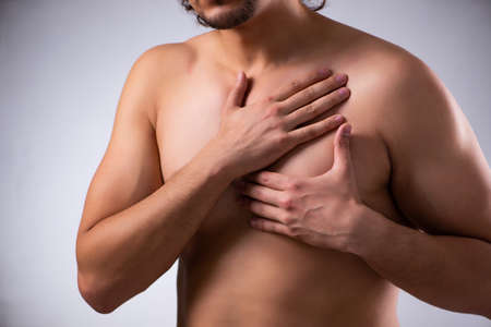 Young man suffering from heart attack Stok Fotoğraf