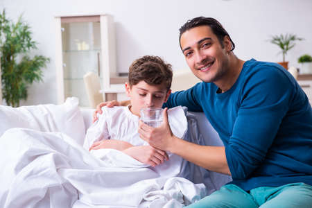 Young father caring for sick son Stok Fotoğraf