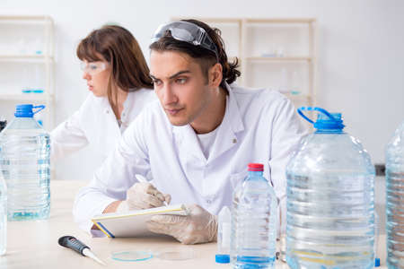 Two chemists working in the lab Stock fotó - 129923638