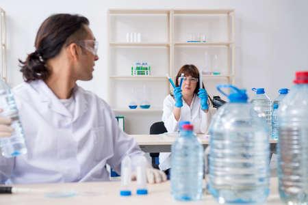 Two chemists working in the lab Stok Fotoğraf