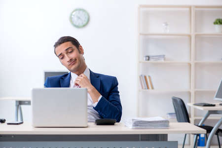 Young male businessman sitting in the office Stock fotó - 129923686