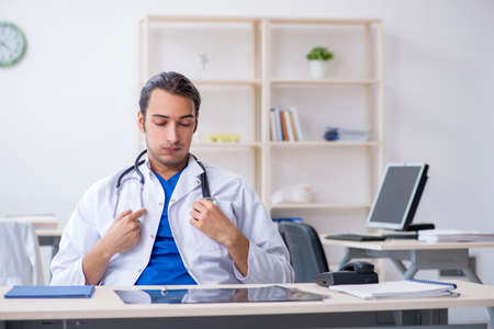 Young male doctor working in the clinic Stok Fotoğraf