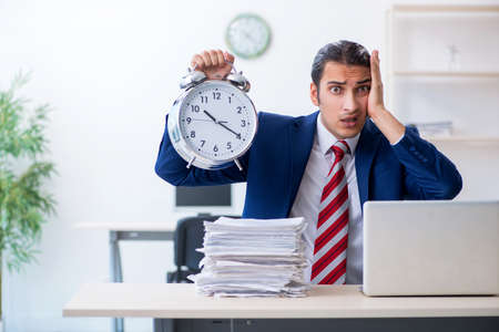 Young male businessman sitting in the office Stock fotó - 129923827