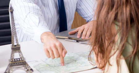 Male travel agent with customer in agency Stock Photo