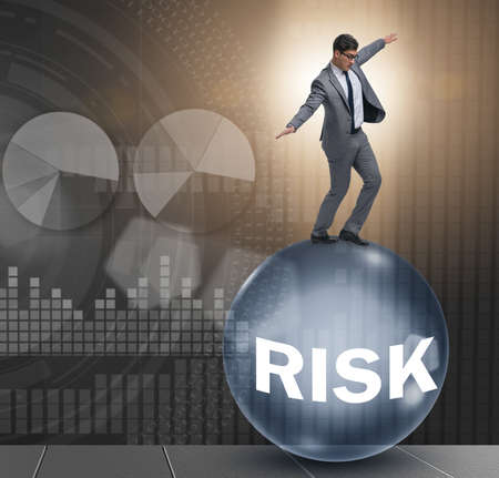 Young businessman in business risk and uncertainty concept Stockfoto