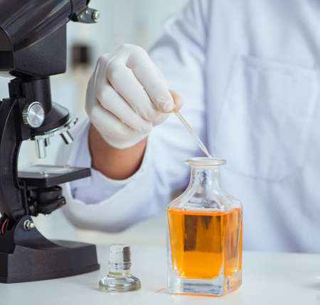 Chemist mixing perfumes in the lab