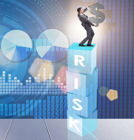 Businessman in risk and reward business concept Stockfoto