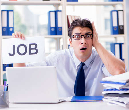 Young businessman looking for job in unemployment concept