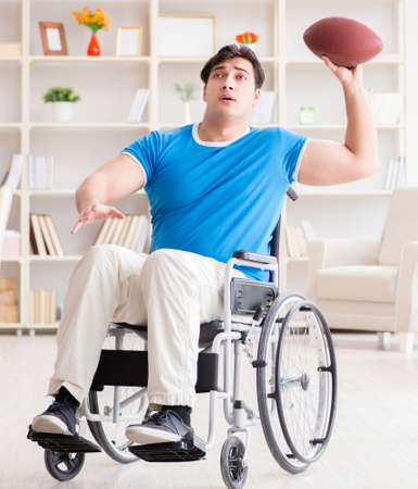 Young man american football player recovering on wheelchair Banque d'images