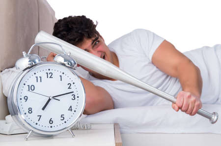 Man in bed suffering from insomnia Imagens